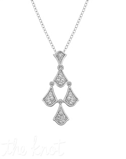 "From The Petal Perfect Collection, this sterling silver pendant features white topaz set in Badgley Mischka's signature symbol. Chain is 18"", pendant is 1-1/8"" L"