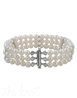 From The Modern Deco Collection, this sterling silver bracelet features three rows of 5mm freshwater pearls and white topaz clasp. 7-1/4&quot; L