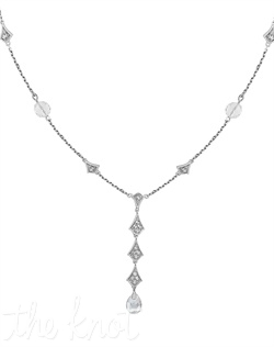 "From The Timeless Glamour Collection, this sterling silver necklace features white topaz and white quartz. 1-1/2"" drop, 18"" chain"