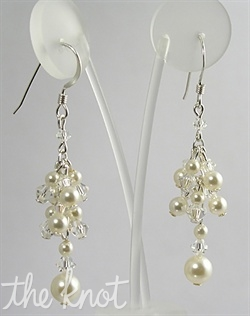 "Sterling silver or 14k gold filled earrings feature Swarovski crystals and pearls. Various colors available. 1.5"" L"