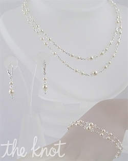 Sterling silver or 14k gold filled necklace, bracelet, and earrings set features Swarovski crystals and pearls. Various colors available. Adjustable