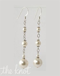 "Sterling silver or 14k gold filled earrings feature Swarovski pearls. Various colors available. 2"" L"