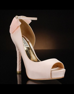 Blush colored platform pump features tulle bow at heel. Optional sparkle on heel.