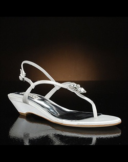 Mini-wedge sandal features crystal on t-strap. Also available in ash or blush.