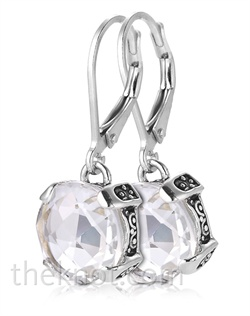 Sterling silver earrings feature white topaz.