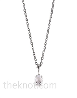 "Sterling silver necklace features white or blue topaz. 16""-18"" L chain"