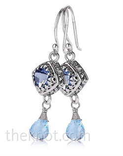 Sterling silver earrings feature Iolite topaz and blue topaz. Matching pendant and bracelet also available.