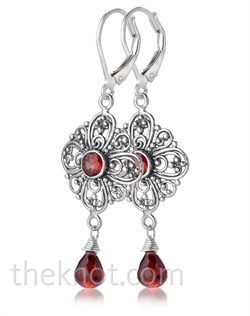Sterling silver earrings feature garnet and filigree design. Matching necklace available.