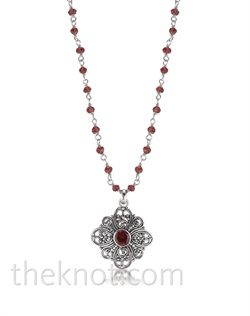 "Sterling silver necklace features garnet and filigree design. Matching earrings available. 16""-18"" L"