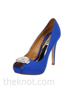 "Silk satin royal blue platform pump features peep-toe, clear crystal brooch and 4-1/2"" heel. Sizes 6-10"