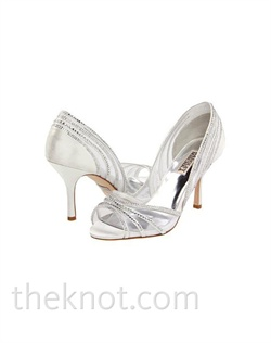 "Diamond white silk satin peep-toe pump features crystals, sheer inserts and 3"" heel. Sizes 5-1/2-10"