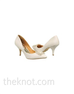 Diamond white silk satin closed-toe pump features crystal brooch and 2-1/2&quot; heel. Sizes 6-10