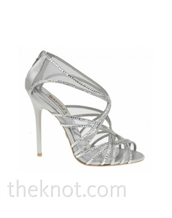 "Silver open-toed sandal features sheer straps, crystal trim and 3-3/4"" heel. Sizes 5-1/2-10"