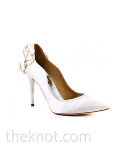 "Diamond white silk satin closed-toe pump features bow at heel and 4-1/2"" heel. Sizes 6-10"
