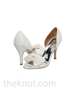 "Diamond white silk satin open-toe pump features tulle bow and 3"" heel. Sizes 6-10"