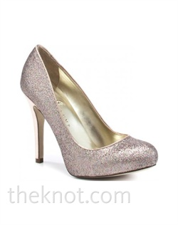 "Multi-tone pink closed-toe pump features rounded toe and 4"" heel. Sizes 6-9-1/2"