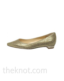 "Gold metallic flat features slight lattice texture and 1/4"" heel. Sizes 6-10"