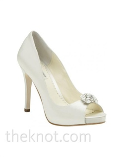 "White or ivory Duchesse silk platform pump features Swarovski crystal brooch and 4"" heel. Sizes 5-10"