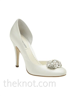 "Dyeable white or ivory Duchesse silk closed-toe pump features Swarovski and alabaster brooch, and 3-3/4"" heel. Sizes 5-10"
