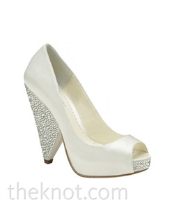 Ivory Duchesse silk platform pump features Swarovski crystals. Sizes 5-10