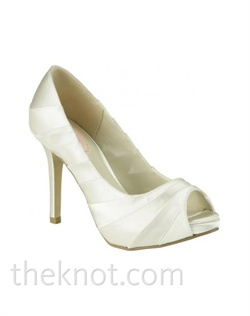 "Dyeable white or ivory satin platform pump features fabric detail and 4"" heel. Sizes 5-10"