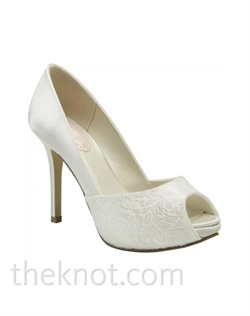 "White or ivory silk satin platform pump features lace overlay and 3-3/4"" heel. Sizes 5-10"