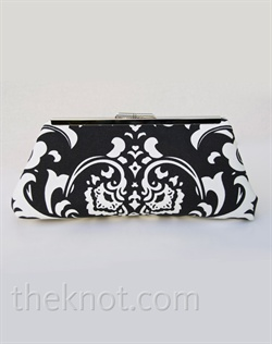 "Clutch features decorator damask fabric, metal frame and silk lining. Various colors available. 6"", 8"", and 10"" available."