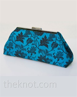 "Clutch features silk brocade, metal frame and satin lining. Various colors available. 6"", 8"", and 10"" available."