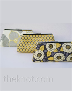 "Clutch set features cotton, metal frame and 100% kona lining. Various colors available. 6"", 8"", and 10"" available."