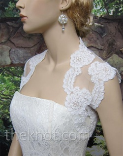 Ivory bolero features Alencon lace. Available in small, medium, large, or extra large.