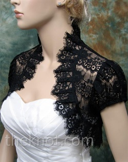 Bolero features lace. Available black or ivory. Small, medium, large, or extra large sizes available.