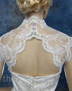 Bolero features Alencon lace. Available in white, ivory, or black. Small, medium, large, or extra large sizes available.