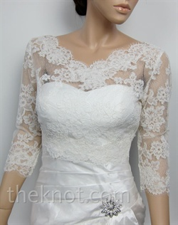 Ivory bolero features lace. Available in small, medium, large, or extra large sizes.