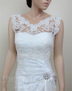 Ivory bolero features Alencon lace. Available in small, medium, large, or extra large sizes.