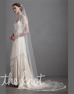 Cathedral-length ivory nylon tulle veil features scallops of lace and plated comb.