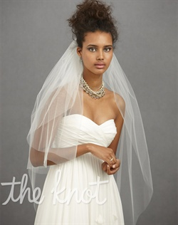 Ivory finger-tip length nylon tulle veil features double layers and nickel-plated comb.