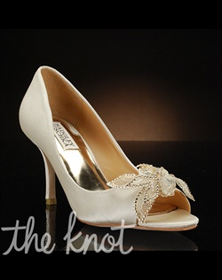 Peep-toe pump features lace and crystal toe decoration. Also available in navy.