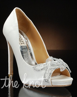Peep-toe pump features lace and crystal toe decoration. Also available in ivory and navy.