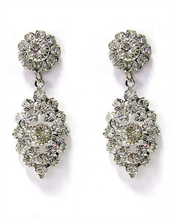 "Rhodium earrings feature vintage-inspired drops with Swarovski elements. 1-1/2"" L"