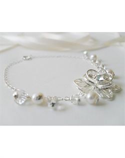 Bracelet features white cultured freshwater pearls, silver chain and beads, rhinestones and silver-plated flower charm with Swarovski crystals. 7 1/2""