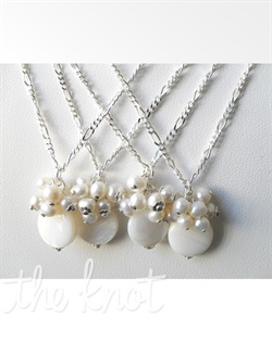 "Set of 4 necklaces feature sterling silver chains, silver floral caps, freshwater pearls and coin mother of pearl disk. Available in white, peach, purple and pink. Available in lengths 16"", 18"", or 20""."