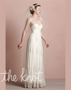 Ivory chapel-length veil features nylon tulle, metal headband and silk flower.