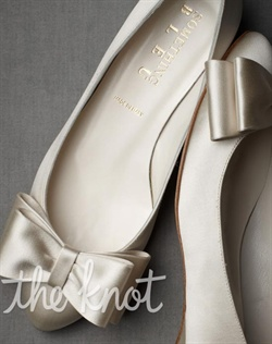 Ivory or French blue flats feature satin-wrapped heel and bow detail. Sizes 5-11