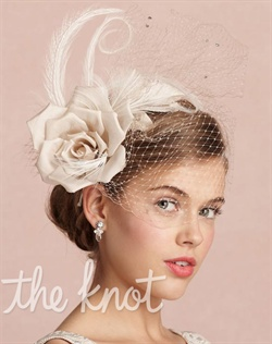 Satin-wrapped metal headband features silk taffeta flower, nylon tulle, feathers, crystals and sequins.