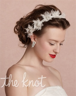 White headband features nylon organza, grosgrain ribbon, sequins, glass beads and crystals.