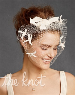 Ivory blusher veil features rayon, velvet star bursts and metal comb attachment.