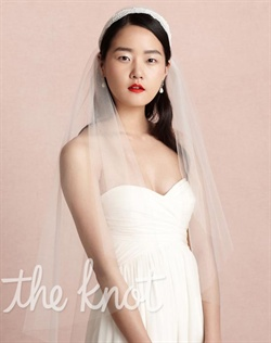 Ivory elbow-length, 1920s-inspired veil features nylon tulle, rayon lace and metal headband.