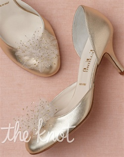 Gold leather-wrapped heels feature twinkling tulle. Sizes 5-11