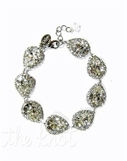 "Rhodium bracelet features Swarovski crystals and crystal bezel accents. 7-1/2"" L"