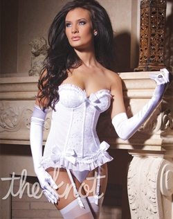 Bustier features Lycra and stretch lace with padded and under wire cups, lace front and back panels, power net sides with boning, ruffle bust and hem detail, removable and adjustable straps and garters, back hook and eye closure and three white satin accent bows. Gloves, stockings and panty not included.